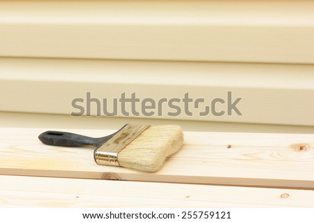 Brush on  wooden board - stock photo