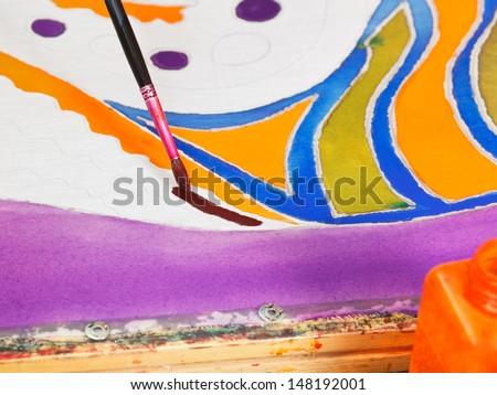 brush painting of cold batik pattern close up - stock photo