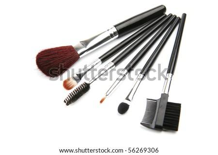 brush set for make-up over white background - stock photo