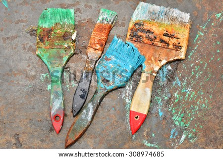 brush to paint in different colors - stock photo