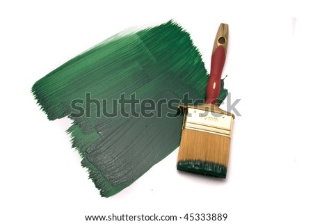 Brush with green paint on the white background