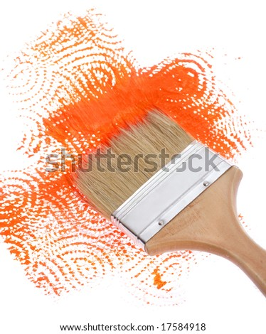 brush with orange path on wall - stock photo