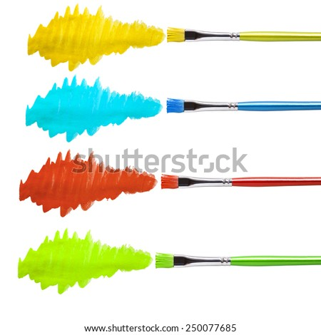 Brush with red,yellow, green , blue  paint stroke and patch, cut out on white.  - stock photo