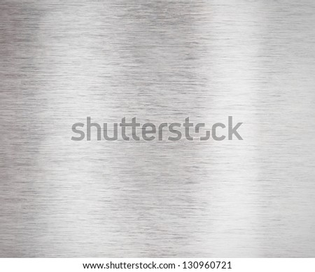 Brushed aluminum metal plate surface - stock photo