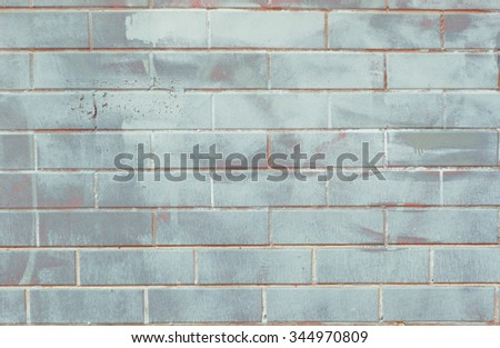 Brushed cold grey tile brick wall texture background. - stock photo