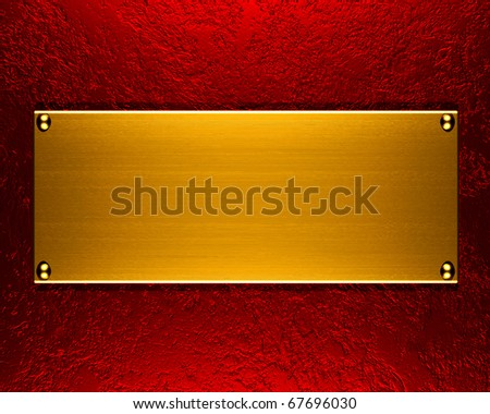 Brushed metal golden plate on red background - stock photo