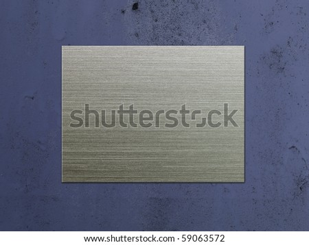 Brushed metal plate on grungy blue wall