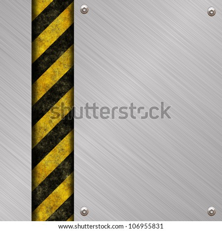 brushed metal plate with warning stripes - stock photo