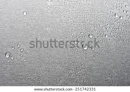Brushed metal surface with water drops - stock photo