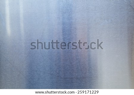 Brushed Metal texture with lighting and lens ghost. - stock photo