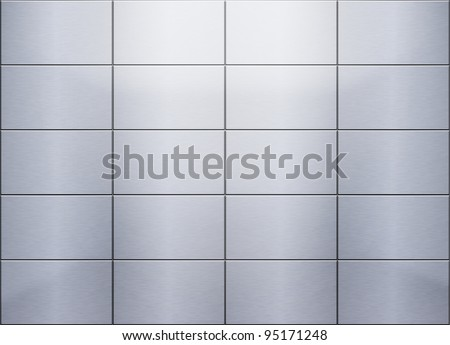 Brushed metal tiled panels at the wall - stock photo