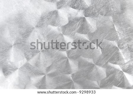 Brushed metal with circle pattern. Texture or background.