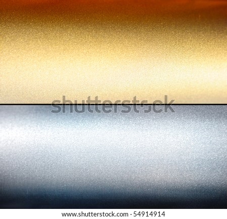 Brushed silver and gold metal - stock photo