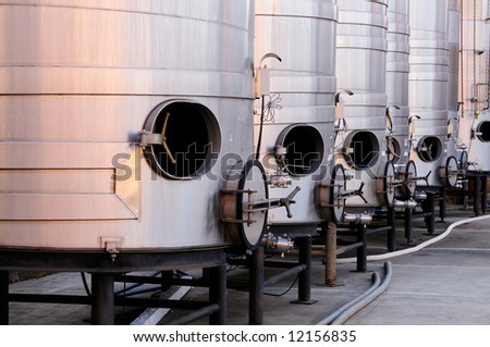 Brushed steel tanks for winemaking waiting for the new grape harvest in Napa Valley, Sonoma County, California - stock photo