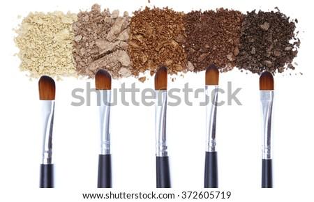 Brushes and eye shadows isolated on white - stock photo