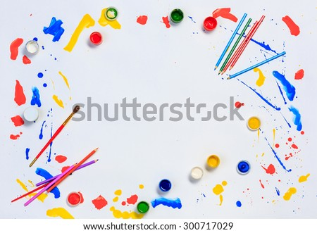 Brushes and painting with gouache on white paper - stock photo