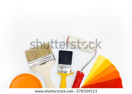 brushes and roller with color guide and paint can - stock photo