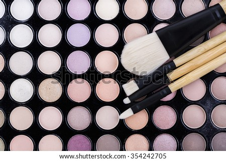 brushes and shadows from the face makeup
