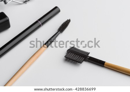 Brushes for eyes in macro. Tools for brushing and applying make-up for highlighting the exceptional look. Isolated. - stock photo