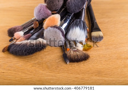 Brushes for make-up on the table - stock photo