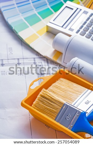 brushes in paintcan blueprints calculator color palette - stock photo