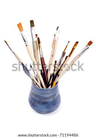 brushes in vase - stock photo