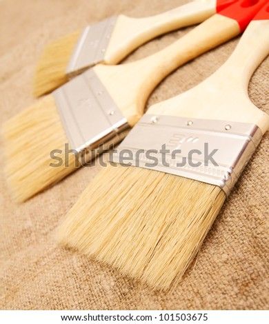 Brushes on a fabric. - stock photo