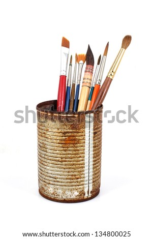 Brushes on the tin can isolated on a white background - stock photo