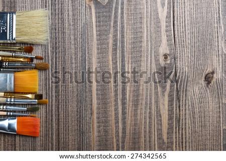 brushes on wood background - stock photo