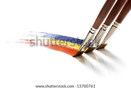 Brushes painting rainbow on white - stock photo