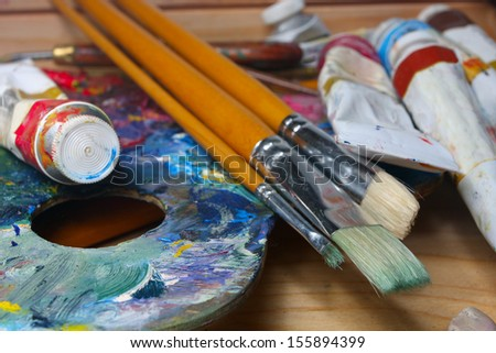 brushes, paints and pallette  - stock photo