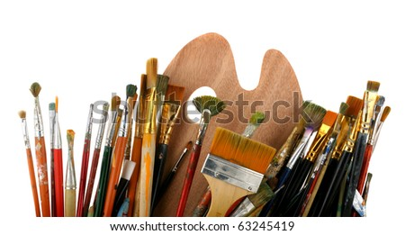 Brushes with a palette isolated on a white background - stock photo