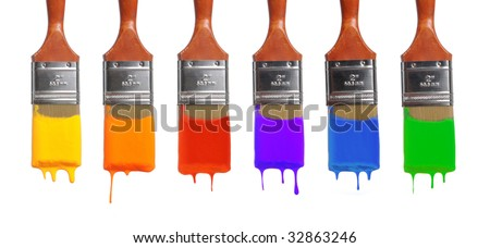 Brushes with paint of different colors dripping - stock photo