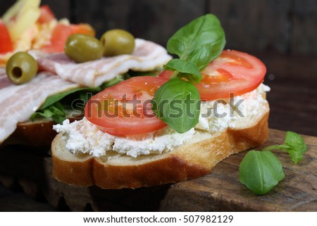 Brushetta. A variety of small sandwiches on dark rustic wooden background