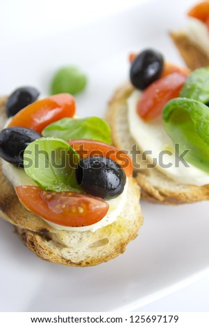 brushetta over white plate - stock photo