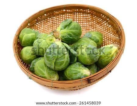 brussel sprout cabbages in basket isolated on white
