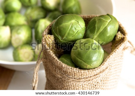 Brussel sprouts in a hessian bag.