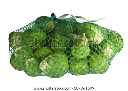 Brussel Sprouts in a net isolated on white background - stock photo