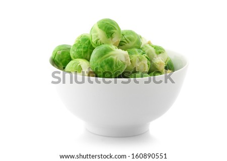 Brussel sprouts in bowl isolated on white background. - stock photo