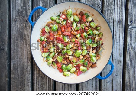 Brussel Sprouts Sauteed with Bacon and Mushrooms  - stock photo