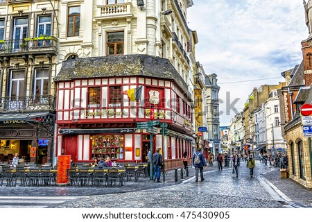 BRUSSELS - APRIL 21, 2016: Typical street in the old quarter of Brussels with outdoor tavern, Belgium