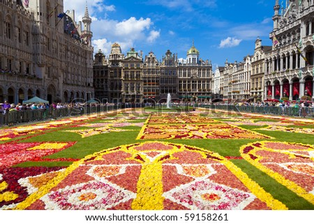 BRUSSELS - AUGUST 14: As every two years thousands of visitors come to see the floral carpet on the Grand Place square on August 14, 2010 in Brussels. Almost 800,000 begonias were used this year. - stock photo
