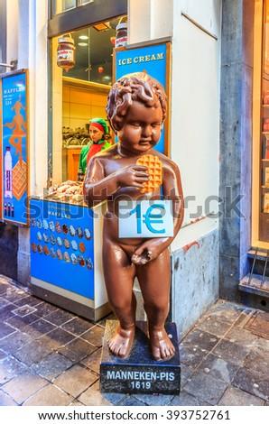 Brussels, Belgian - January 17th, 2015: Chocolate version of of the famous Manneken Pis statue in Brussels, holding the famous Belgian waffle in front of a waffle shop - stock photo