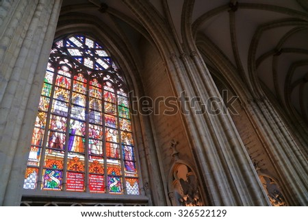 Brussels, Belgium - APR 11 2015: Large window decorated with stained glass inside the Cathedral of St Michael and St Gudula  - stock photo