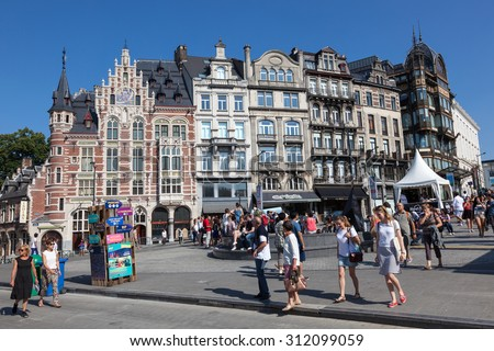 BRUSSELS, BELGIUM - AUG 22: People on the street with traditional buildings in the city of Brussels. August 22, 2015 in Brussels, Belgium - stock photo