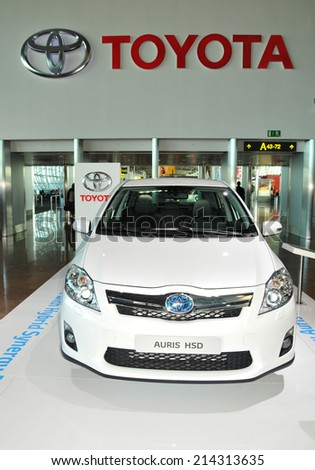 BRUSSELS, BELGIUM - AUGUST 30, 2010: Motor car show featuring the new Toyota Auris HSD release from the famous automobile manufacturer - stock photo