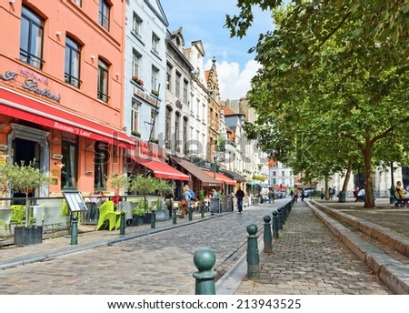 BRUSSELS, BELGIUM-AUGUST 29, 2014: Place Saint Catherine, which was built on place of the old port. This square is a favorite place for tourists searching Belgian sea food restaurants. - stock photo