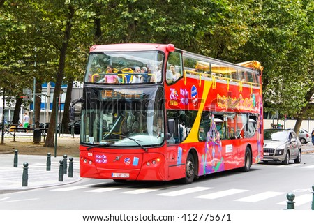 BRUSSELS, BELGIUM - AUGUST 9, 2014: Red city sightseeing bus UNVI Urbis in the city street. - stock photo