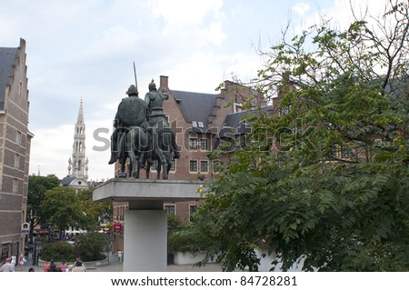 BRUSSELS, BELGIUM - AUGUST 18: View of Brussels with Don Quixote & Sancho Panza Statue and Town Hall Building in the distance on August 18, 2011 in Brussels, Belgium.