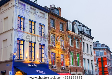 BRUSSELS, BELGIUM - DECEMBER 13, 2014: Christmas decorations on shops selling Belgian chocolate and beer in Place du Grand Sablon in Brussels, Belgium - stock photo